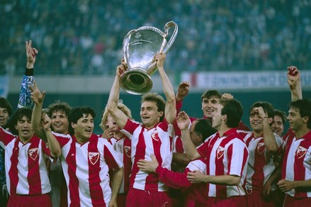 Dragisa Binic of Red Star Belgrade holds up the trophy with other members of his team at the Stadio San Nicola in Bari, Italy, after they won the European Cup Final against Marseille, 29th May 1991. They won 5-4 on penalties. (Photo by Simon Bruty/Getty Images)